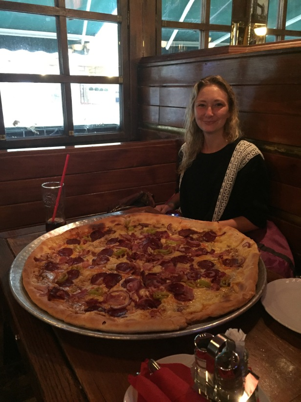 They also love pizza here, as well they should. Everyone loves pizza! I'm not so good at the metric system so I ordered a 60cm diameter pizza, which it turns out is fucking gigantic (tiny English girl shown for comparison).