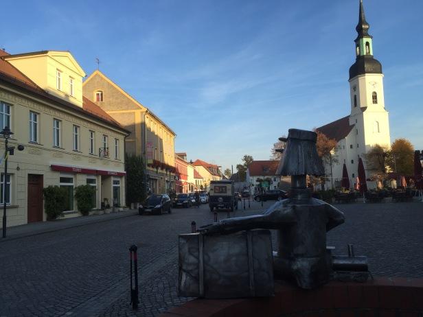 The main street of Lübbenau near sunset.